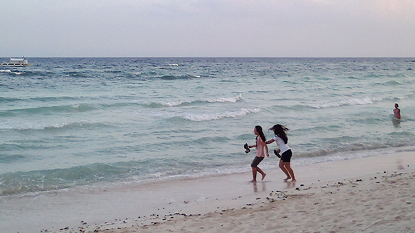 Ashley Uy pushing her sister into the ocean